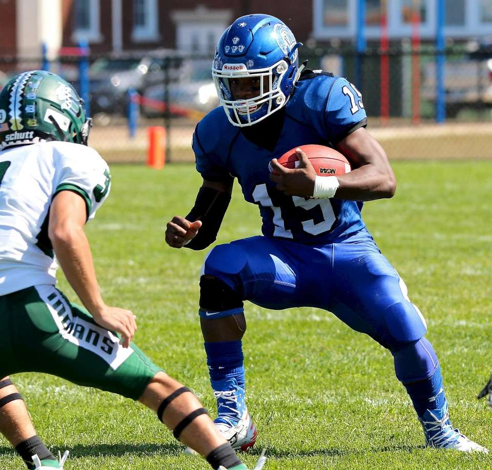 Riverhead RB Albert Daniels carries the ball 6