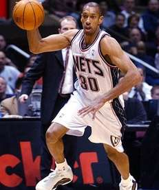 New Jersey Nets' Kerry Kittles drives to the