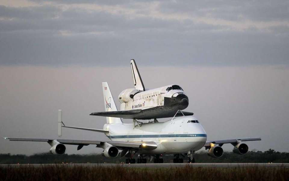 Space Shuttle Discovery atop a 747 carrier jet