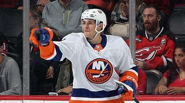 Mathew Barzal #13 of the Islanders celebrates his