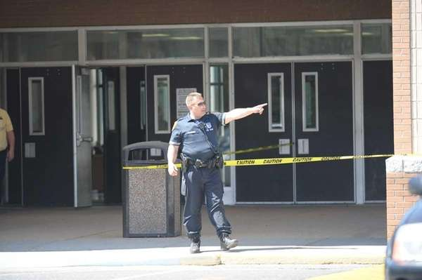 A policeman stands guard at the side entrance