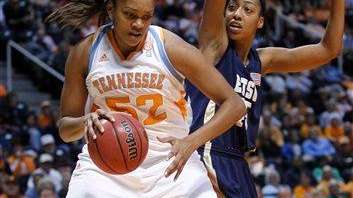 Tennessee's Kelley Cain (52) works the ball against