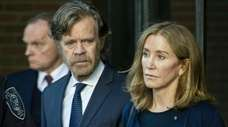 Actress Felicity Huffman, escorted by her husband William