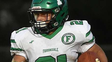 Dominic Ciaccio #21 of Farmingdale rushes for an