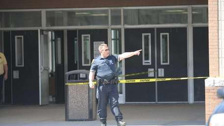 Police stands guard at side entrance to William