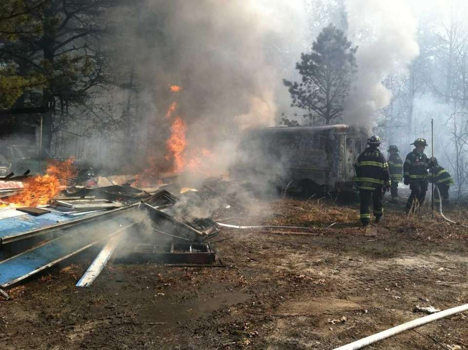 Firefighters battle a brush fire at 155 Weeks