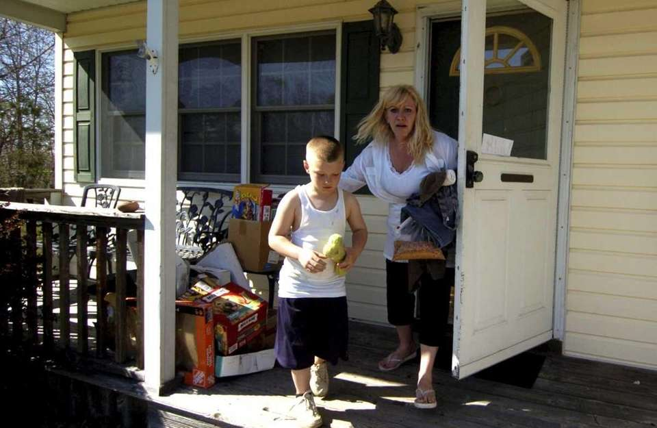 Susan Swezey and her nephew Justin Brown, leaving