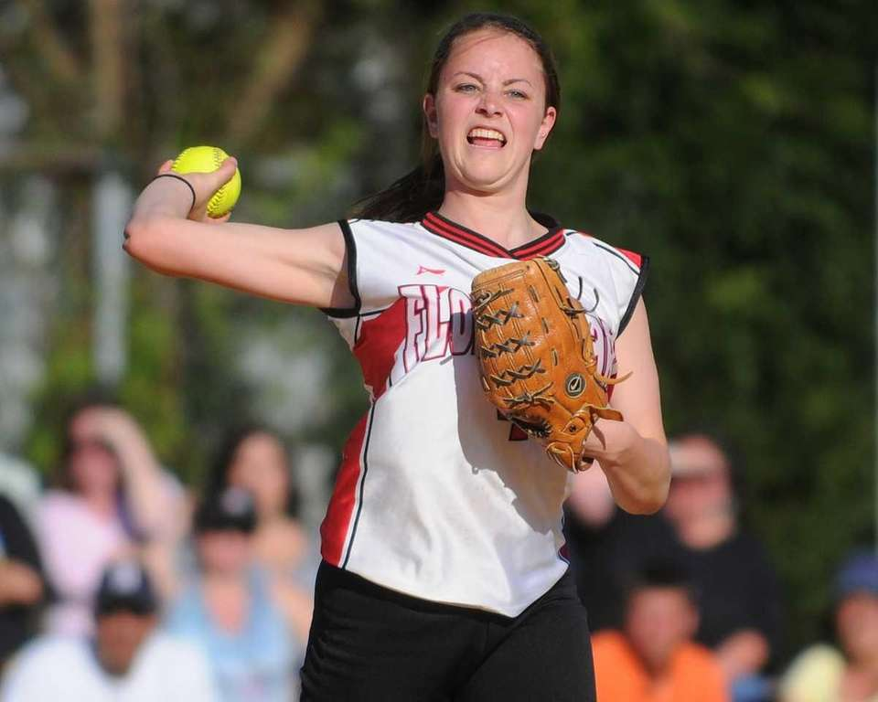 Floral Park's Kristina Santoro throws to first base