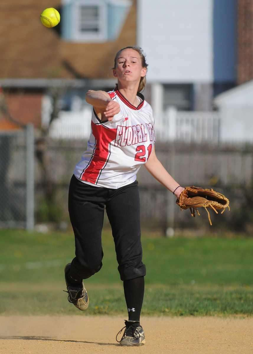Floral Park shortstop #21 Christine Hand throws to