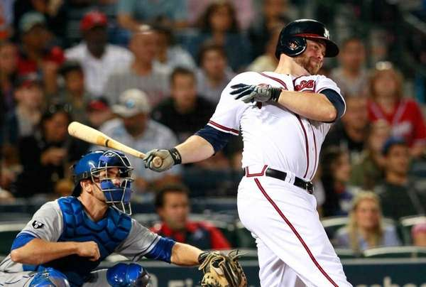 Brian McCann of the Atlanta Braves hits a