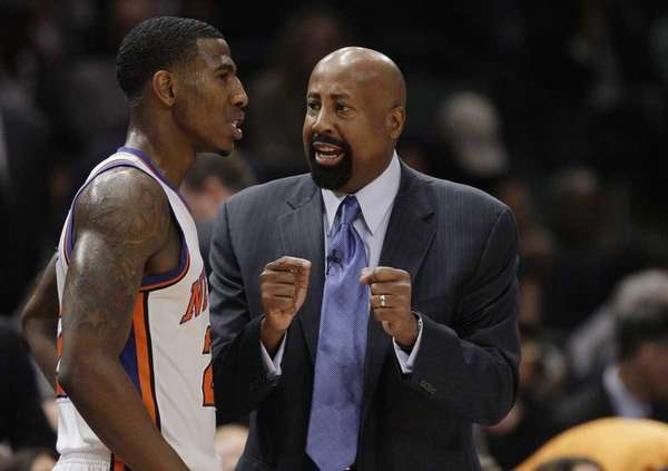 Knicks head coach Mike Woodson talks to Iman