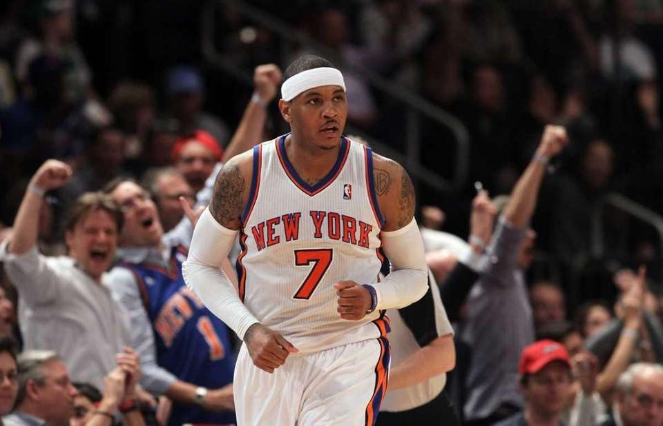 Carmelo Anthony reacts after a basket against the
