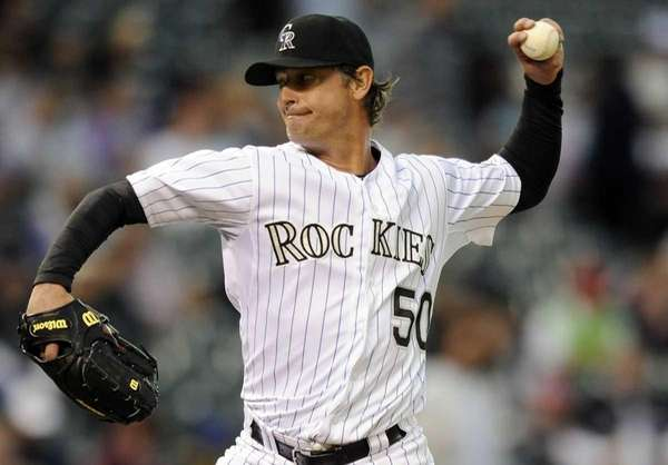 Colorado Rockies starting pitcher Jamie Moyer throws in