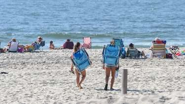 Two women head to the beach at Gilgo