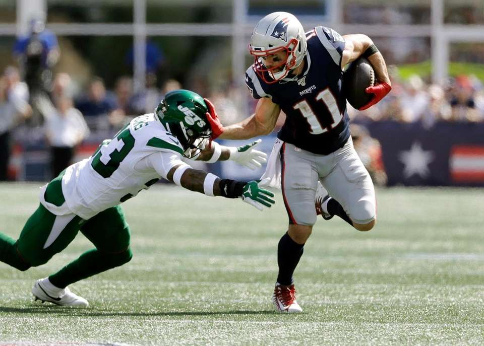 Patriots wide receiver Julian Edelman, right, tries to