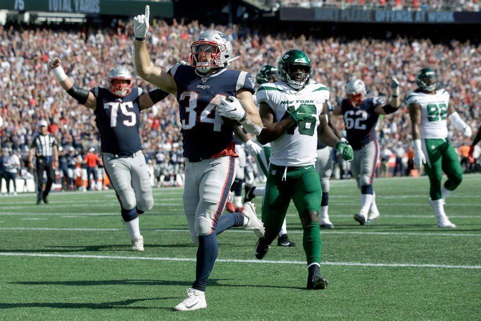 Patriots running back Rex Burkhead carries the ball