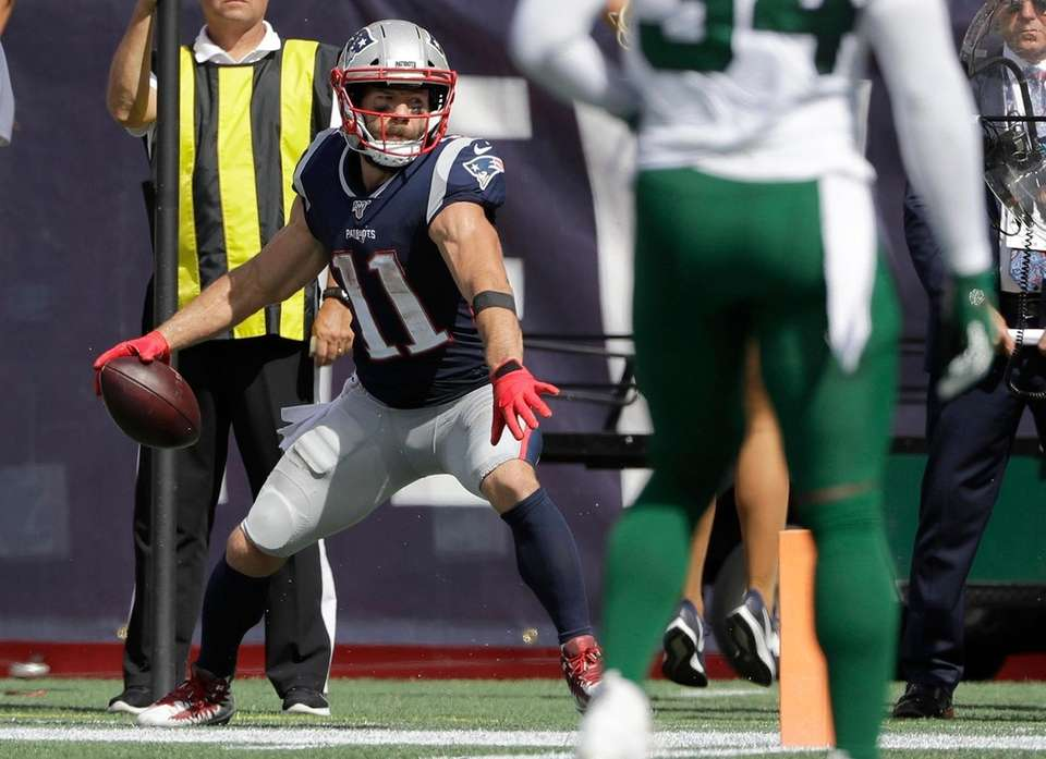 Patriots wide receiver Julian Edelman winds up to