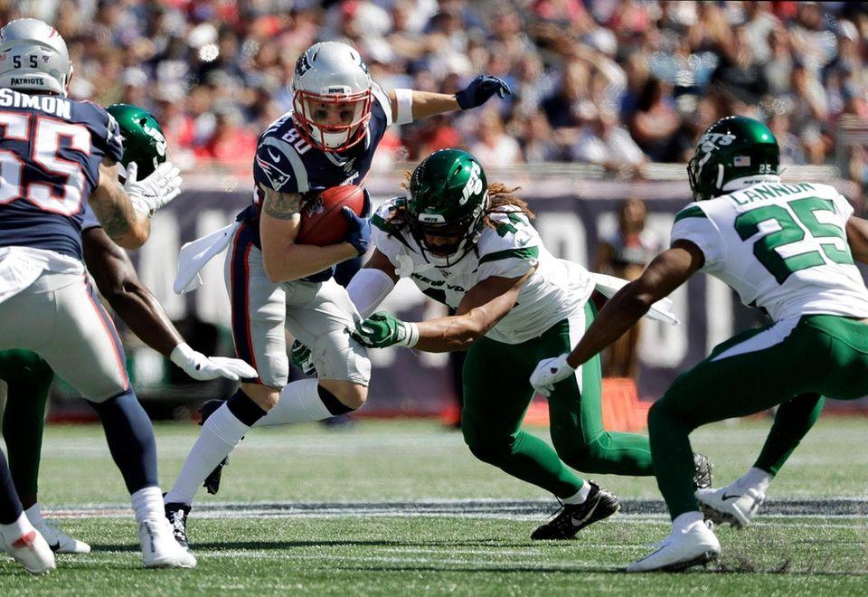 Patriots wide receiver Gunner Olszewski tries to elude
