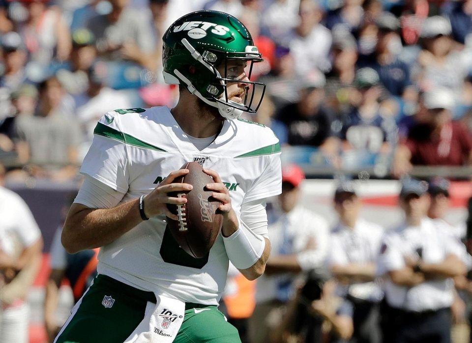 Jets quarterback Luke Falk drops back to pass