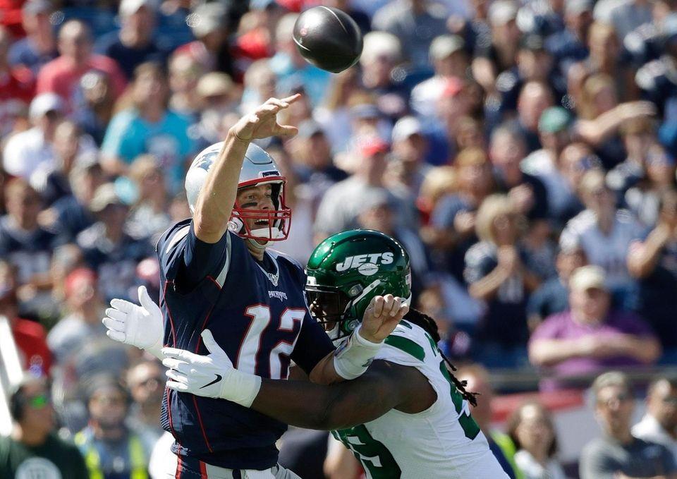 Patriots quarterback Tom Brady passes under pressure from