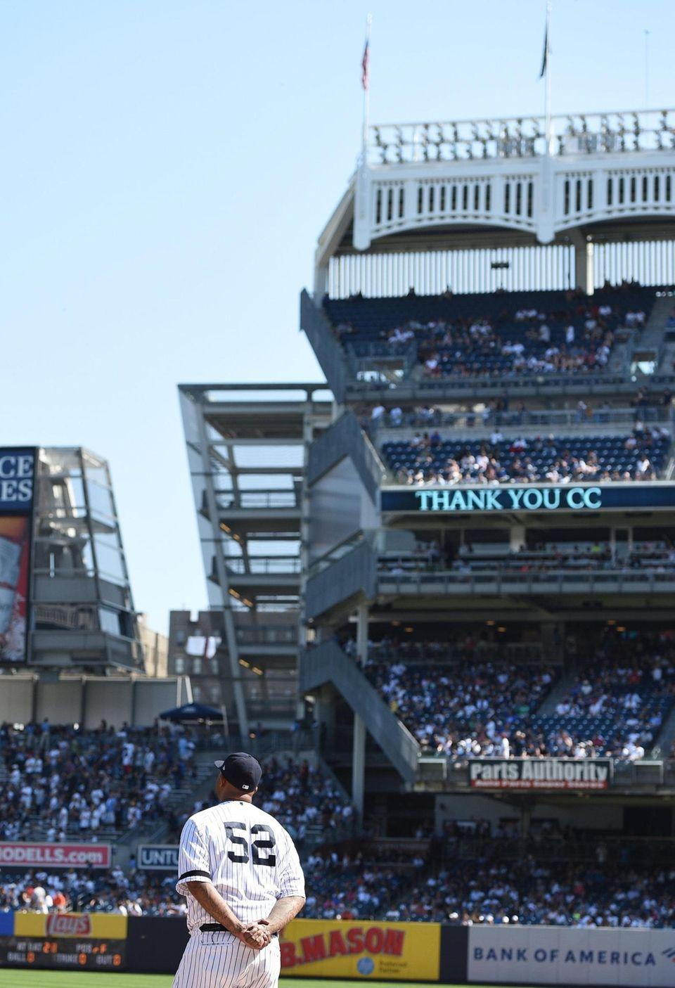 New York Yankees pitcher CC Sabathia watches as