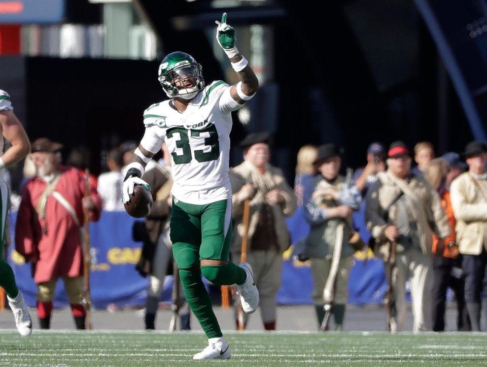 Jets safety Jamal Adams celebrates after he intercepted