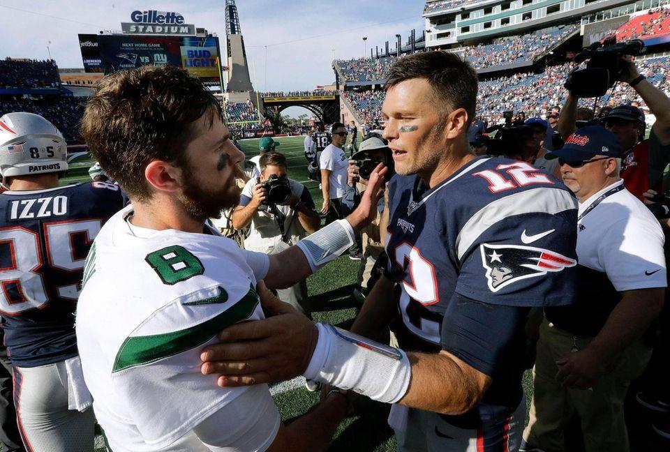 Jets quarterback Luke Falk, left, and Patriots quarterback