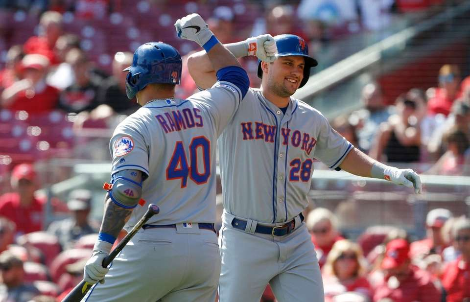 The Mets' J.D. Davis bumps elbows with Wilson