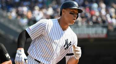 Yankees designated hitter Aaron Judge runs home on