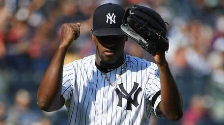 Yankees starting pitcher Luis Severino reacts as he