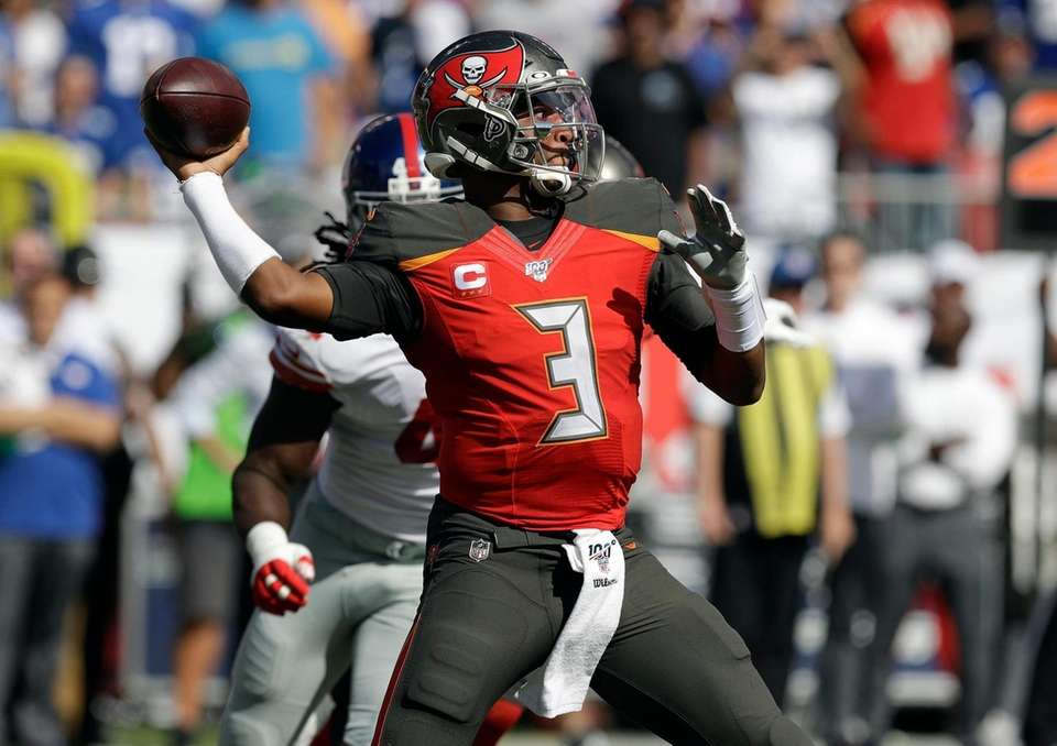 Then-Buccaneers quarterback Jameis Winston throws a pass against