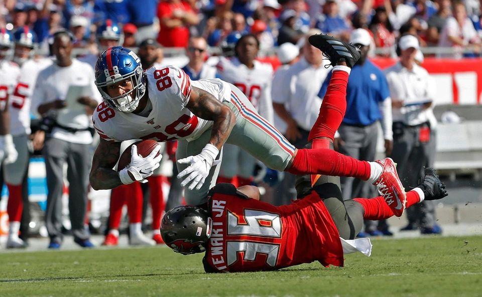 Giants tight end Evan Engram runs over Tampa
