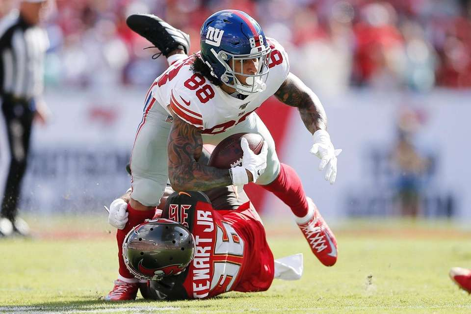 Evan Engram of the Giants is tackled by
