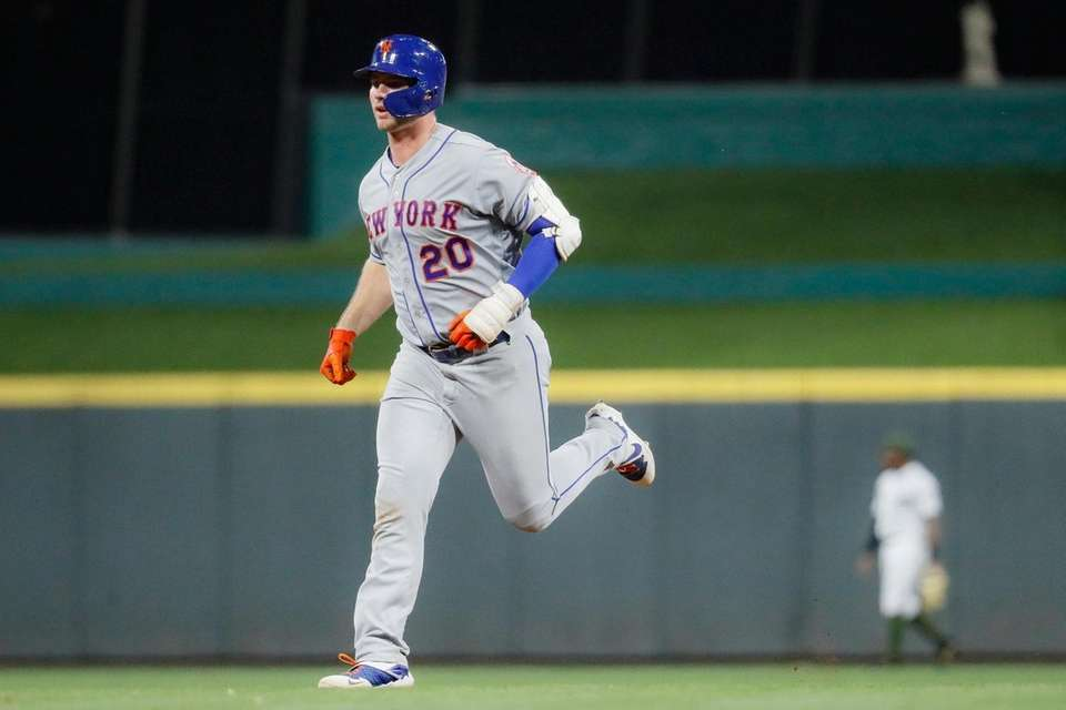 The Mets' Pete Alonso runs the bases after