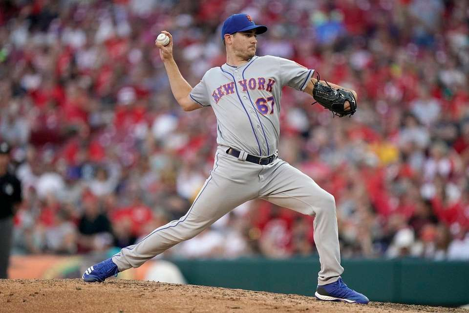Seth Lugo of the Mets pitches during the
