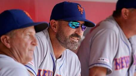 Mets manager Mickey Callaway sits in the dugout