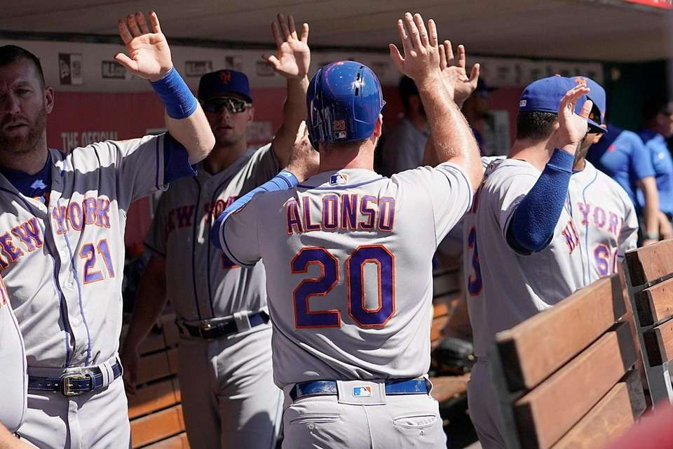 The Mets' Pete Alonso celebrates with teammates after