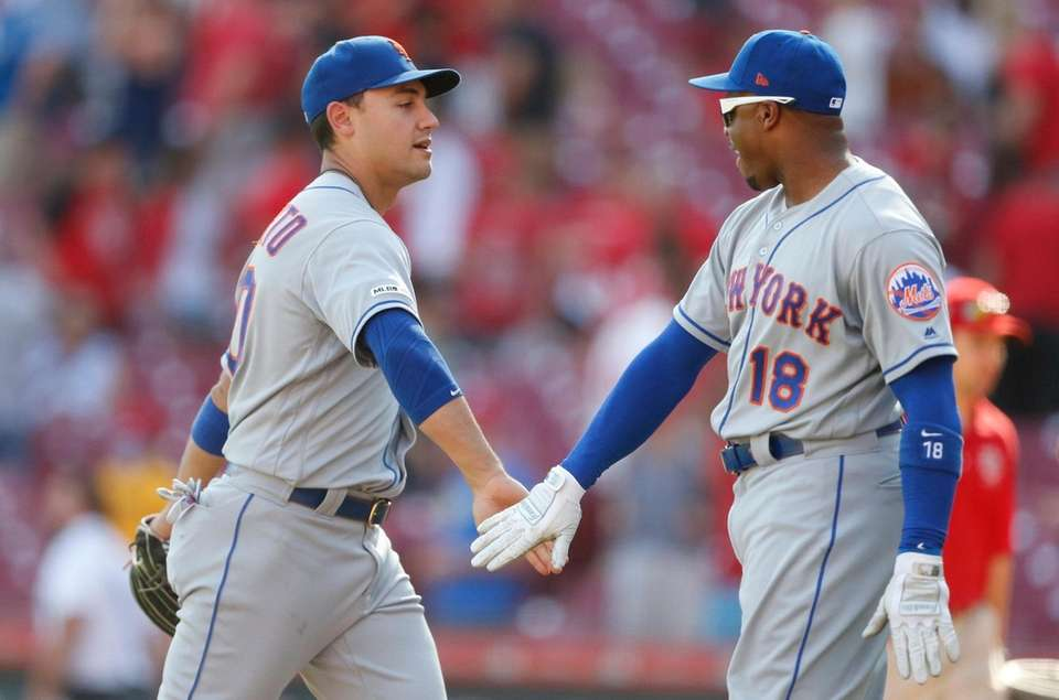 The Mets' Michael Conforto and Rajai Davis celebrate