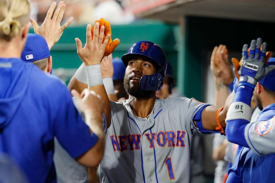 The Mets' Amed Rosario celebrates his two-run home
