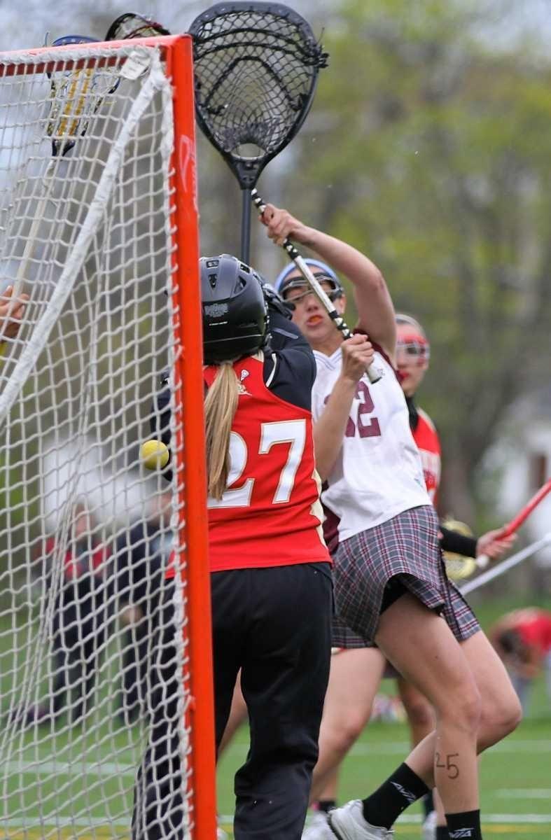 Bay Shore's Caroline deLyra #12 puts the shot