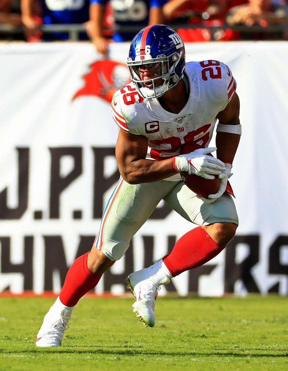 Saquon Barkley #26 of the Giants rushes during