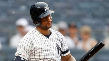 Yankees centerfielder Aaron Hicks strikes out during the