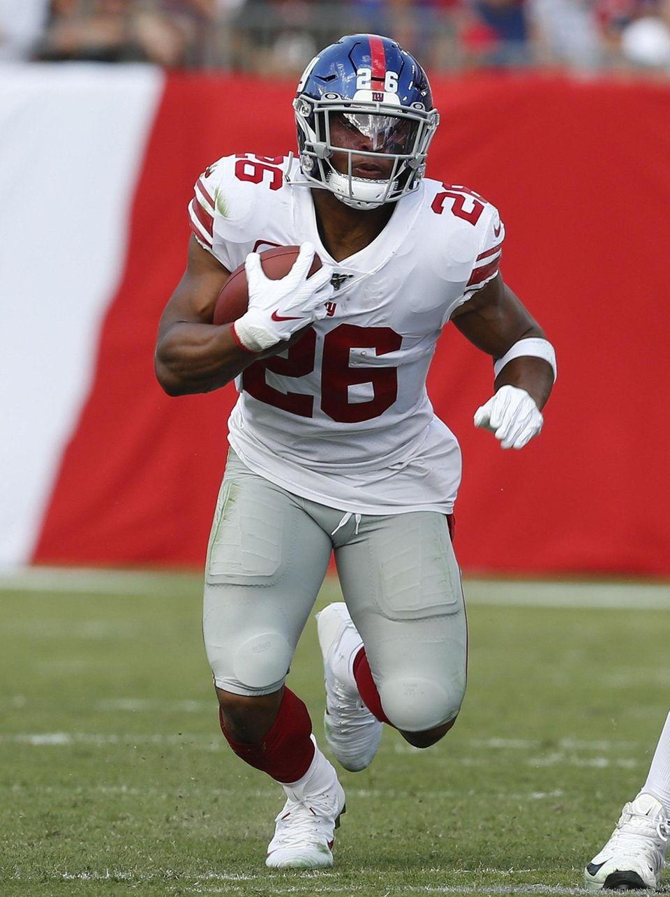 Running back Saquon Barkley of the Giants runs