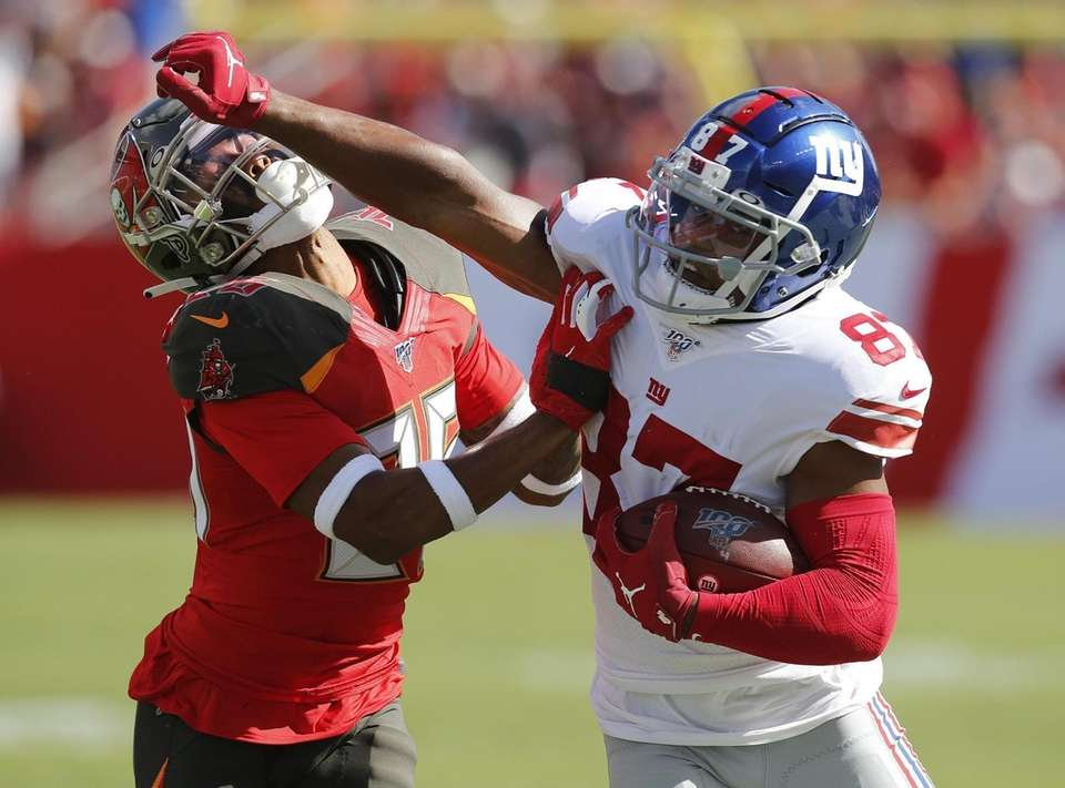 Wide receiver Sterling Shepard of the Giants stiff-arms