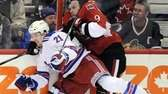 Ottawa Senators' Milan Michalek, right, is hit into