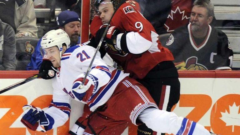 Ottawa Senators' Milan Michalek, right, is hit into