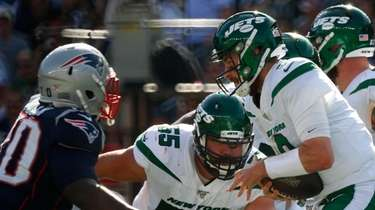 Jets quarterback Luke Falk is sacked by New