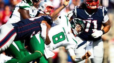 Luke Falk of the Jets is taken down