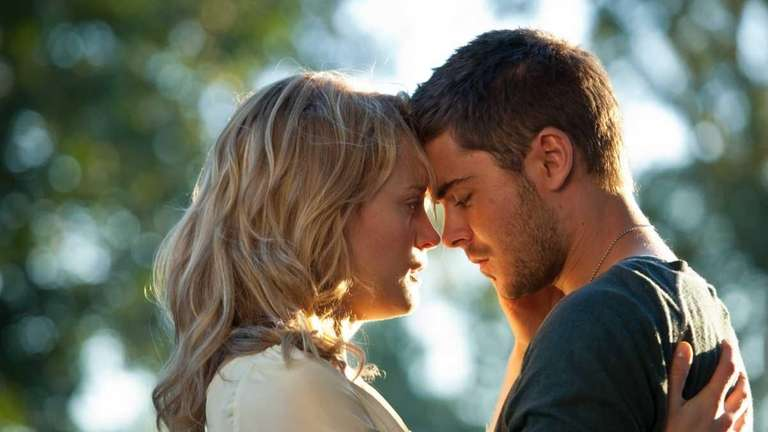 Taylor Schilling, left, and Zac Efron star in