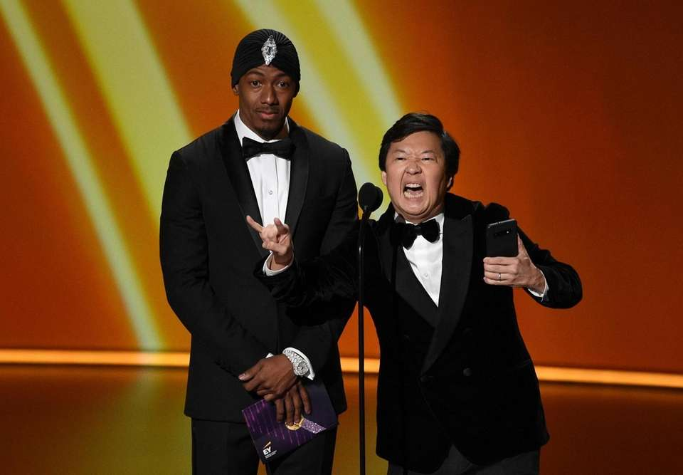 Nick Cannon, left, and Ken Jeong present the